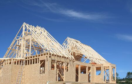 rafter: The frame of a new house under construction. Stock Photo