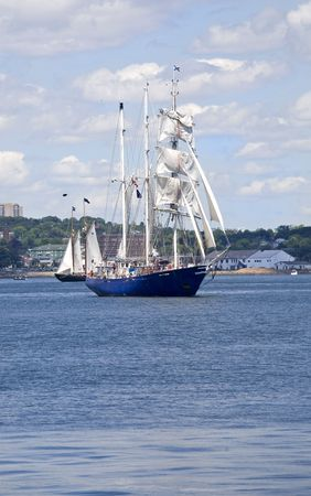 tall ship: Tall ships sailing around Halifax Harbour during the sail past in the Nova Scotia Tall Ship Festival.