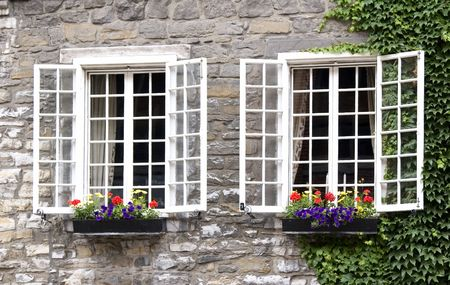Flowering window boxes on an historic building in old Montreal, Canada.