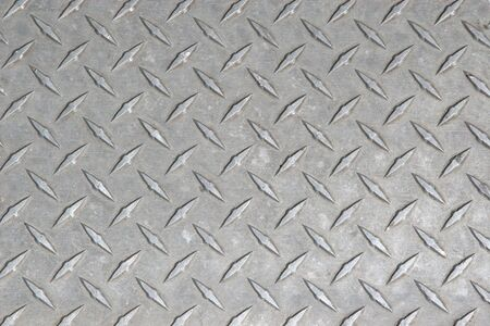 diamond plate: A large seamless sheet of slightly worn and scratched aluminium or nickel diamond or tread plate. Stock Photo