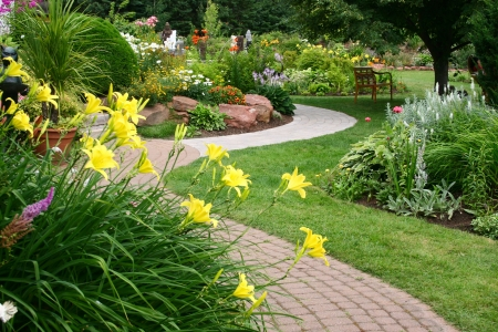 natural landscape: A stone walkway winding its way through a tranquil garden. Stock Photo
