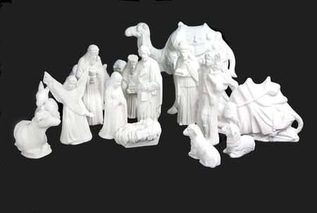 Complete set of white ceramic Nativity figurines. photo
