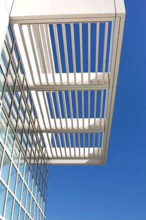 Features of modern architecture against a bright blue sky.