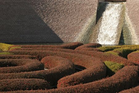 This water inclosed round maze (or water sculpture)is part of the fantastic landscape architecture to be found at the Getty Center, Los Angeles, California. Show is winter coloration of plants. photo