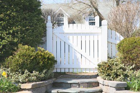 A garden gate in a residential spring garden.