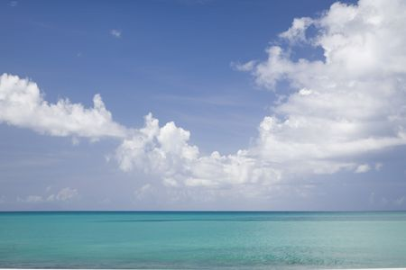 The tropical horizon and big skies for the shores of the Caribbean island of Antigua.