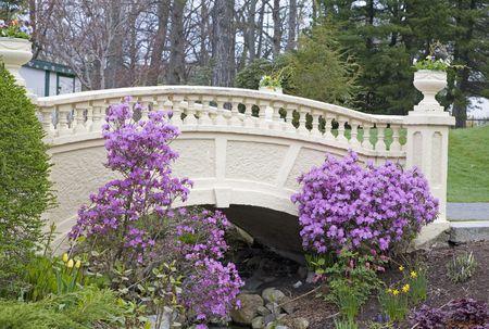 A small ornamental bridge in a spring garden. photo