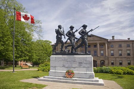 Charlottetown War Memorial with Province House in the background.  Located in Charlottetown, Prince Edward Island Stock Photo - 6402721