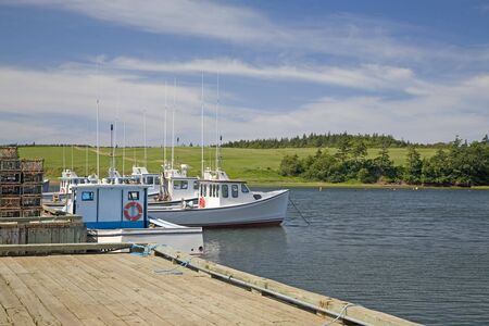Lobster boats tied up at the wharf on Prince Edward Island. photo