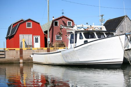 commercial fisheries: Lobster fishing boat tied up at the wharf in Malpeque, Prince Edward Island, Canada.