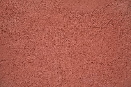 stucco: A warm rust colored painted stucco wall on a Bermuda building. Stock Photo