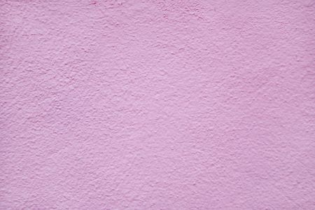 stucco: Pink painted stucco wall on a Bermuda building.
