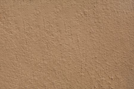 stucco: A tan colored painted stucco wall on a Bermuda building. Stock Photo