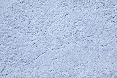 stucco: A blue painted stucco wall on a Bermuda building.