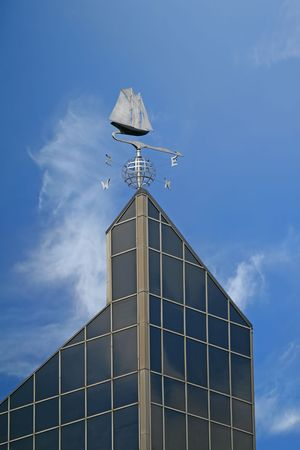 schooner: A weather vane,  with a compass, in the shape of the schooner The Bluenose on top of the World Trade Building in Halifax, Nova Scotia.