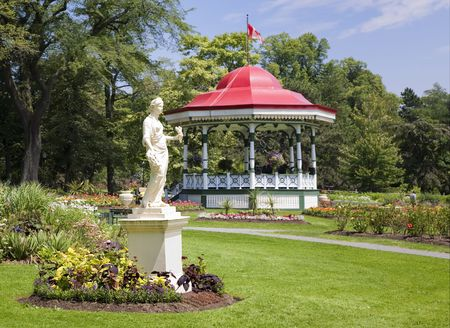 The bandstand gazebo and the statue of the Roman goddess Flora at the Halifax Public Gardens in Halifax, Nova Scotia, Canada.