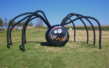 A giant Halloween spider on the farm made of covered haybales and irrigation tubing.