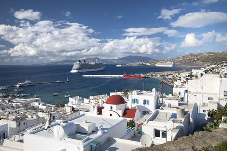 Cruise ships docked at a port on the shoreline of Mykonos, Greece. Stock Photo