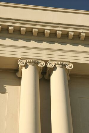 Regal Ionic columns in the front of a building.