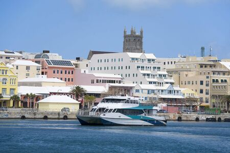 cruising: A Bermuda ferry cruising past the downtown waterfront of Hamilton, Bermuda.