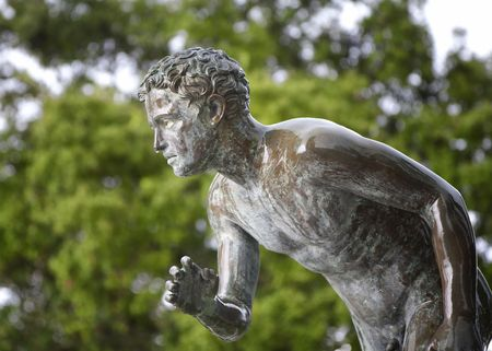A statue of The Runner in the garden of Achilleion, the summer palace of Sissi, empress Elisabeth of Austria, at Corfu island, Greece Stock Photo