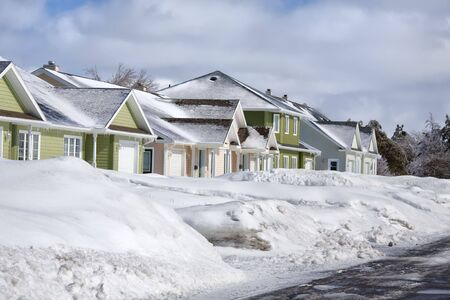 Snow piled up along a plowed road in a northern suburb. photo