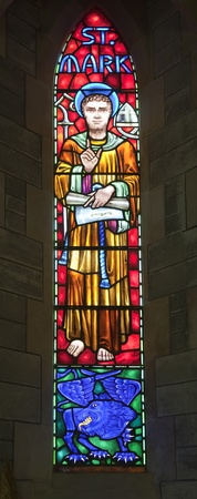 evangelical: St. Mark and the winged lion.  The winged lion is the evangelical symbol of St. Mark. A stained glass window from the Anglican Bermuda Cathedral built in 1866. Located in Hamilton.
