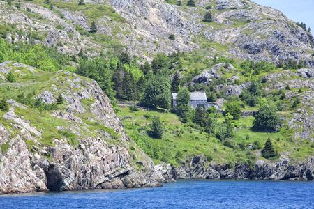 rural community: The steep rocky shoreline of the rural community of Brigus, Newfoundland, Canada. Stock Photo