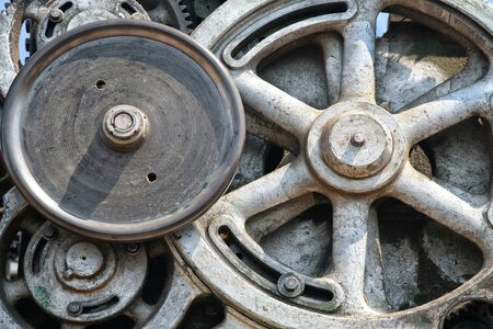 Detail of of an old grungy piece of industrial machinery used in a manufacturing process. Stock Photo