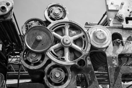 industrial: Detail of of an old grungy piece of industrial machinery used in a manufacturing process. Stock Photo