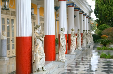 Sculptured Greek influenced figures on the grounds of the Achillion Palace on the island of Corfu.  Stock Photo