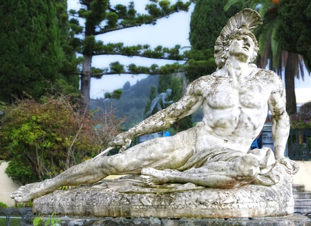 Statue of Achilles dying, shot in the foot with an arrow.  Located in the gardens of the  Achillion Palace, Corfu, Greece.