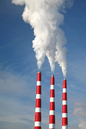 Industrial smoke stack of coal power plant. photo