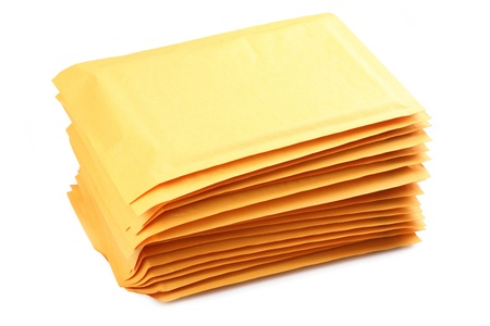 padding: A stack of bubble padded envelopes on a white background.. Stock Photo