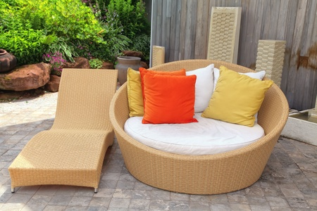 furniture: Modern wicker garden furniture on the home patio.