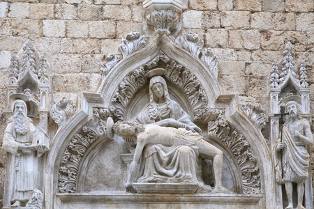 Statue of Our Lady of Sorrow on the portal of the Franciscan church of the Friars Minor, St. Saviour Church, in Dubrovnik.  Completed in 1528.
