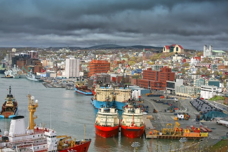 Storm clouds form over the city of St. Johns and St. Johns busy harbour. photo