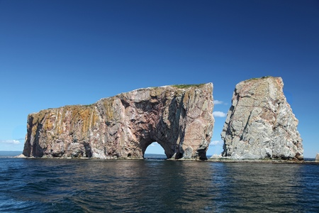 Perce Rock from the sea, Atlantic Ocean, Quebec, Canada Stock Photo