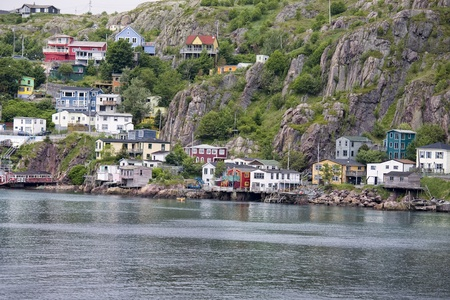 Colorful houses on the rocky shore of Signal Hill facing the harbour in St. Johns, Newfoundland, Canada.  A section of town known as the Lower Battery.