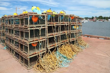 lobster pots: A pile of lobster traps stacked up on a wharf in rural Prince Edward Island, Canada. Editorial