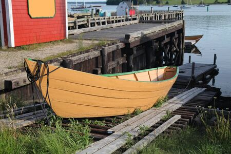 slipway: A traditional wooden dory on a slipway in Lunenburg, Nova Scotia, Canada.