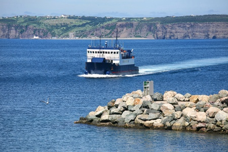 Newfoundland car ferry traveling from Belle Island to the mainland of Newfoundland, Canada. Stock Photo