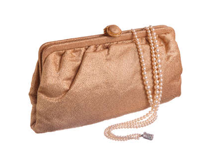 A vintage gold lame evening purse with a triple strand of pearls. photo