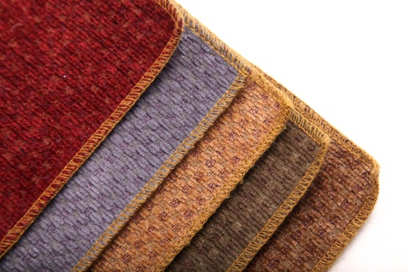 A book of  upholstery carpet samples.