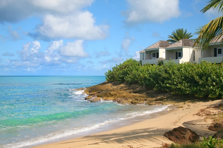 antigua: A secluded beach along the waterfront of the island of Antigua in the Caribbean. Editorial