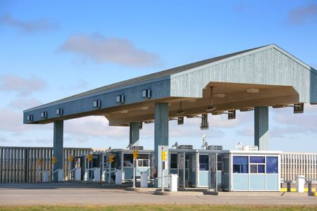 toll: Exit of the multi lane toll booths of the Confederation Bridge, Prince Edward Island, Canada.