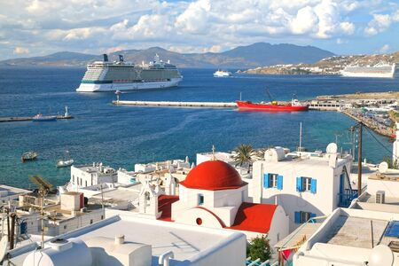 Cruise ships docked at a port on the shoreline of Mykonos, Greece Editorial