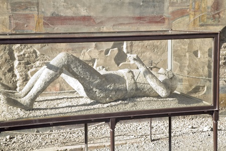 ruined: Pompei was destroyed by the eruption of Mt. Vesuvius during 2 days in 79AD. This is a plaster cast of one of the victims displayed to the public on site in a glass case.