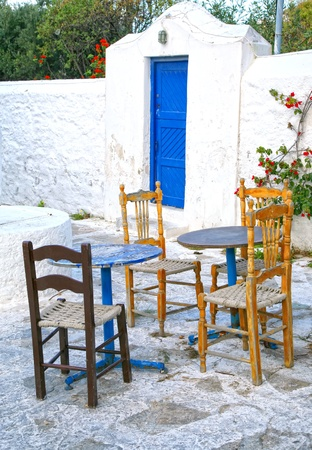 seating area: An abandoned outside restaurant seating area offseason on Mykonos. Editorial