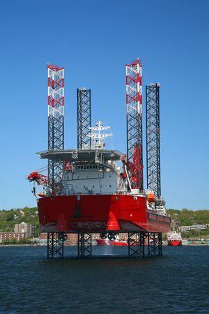 Ocean going oil rig in Halifax Harbor, Nova Scotia, Canada.  Dartmouth can be seen along the shoreline.